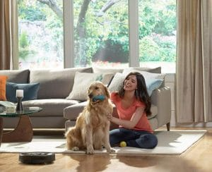 Woman and Dog Near The Automatic Vacuum Cleaner