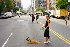 Woman with Dog at the Middle of the Street