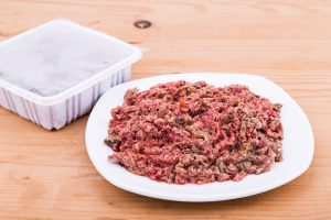 Raw dog food packed and served on a plate